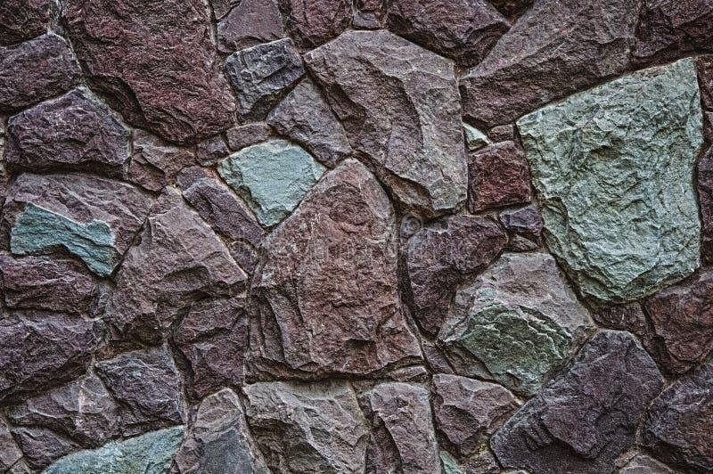 Текстура и предпосылка камня гранита Красный и зеленый цвет стоковое изображение rf