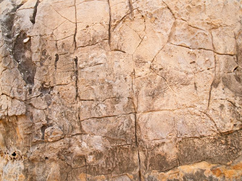 Текстура камня используемая для фоновых изображений, поверхности каменного коричневого цвета стоковое фото