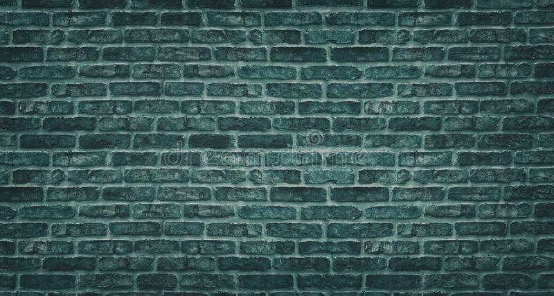 Текстура кирпичной стены Teal Темный каменный masonry блока Грубая предпосылка года сбора винограда кирпичной кладки стоковое изображение