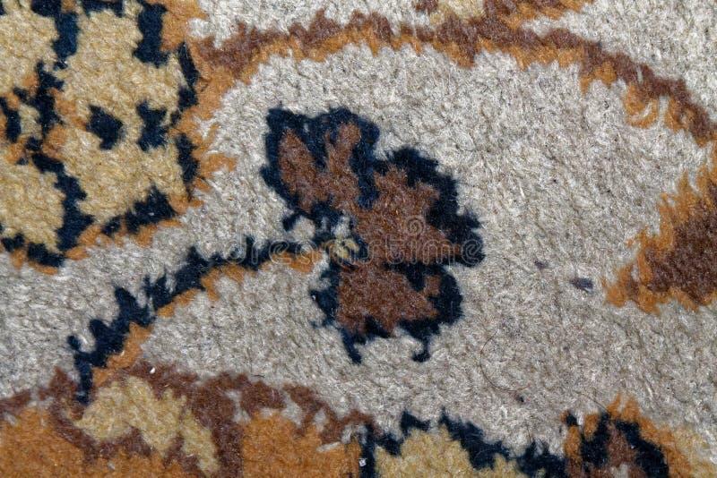 Текстура ковра, абстрактный орнамент цветка макроса Ближневосточная традиционная предпосылка ткани ковра стоковые фото