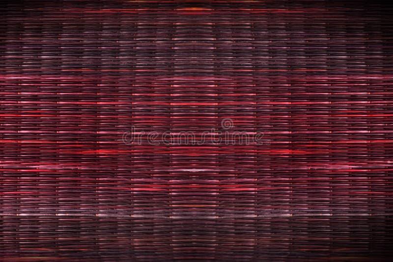 Текстура красной камышовой предпосылки циновки стоковые фото