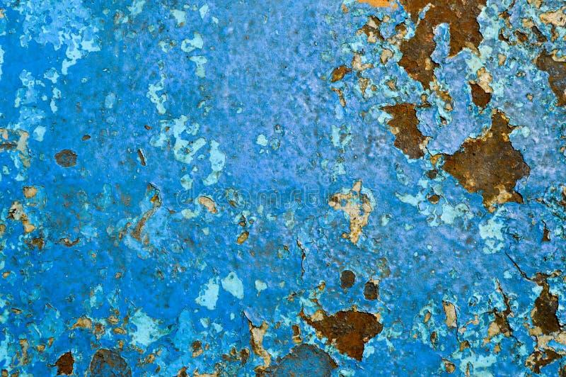 Текстура металла утюга покрасила голубая старую краски поколоченный поцарапанный треснула старую ржавую стену металлического лист стоковые изображения
