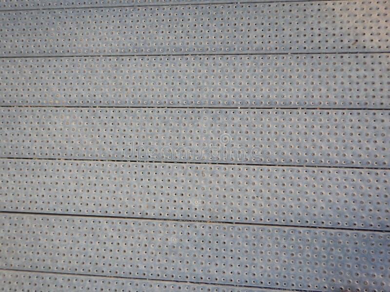 Текстура металла perfored серым цветом стоковое фото rf