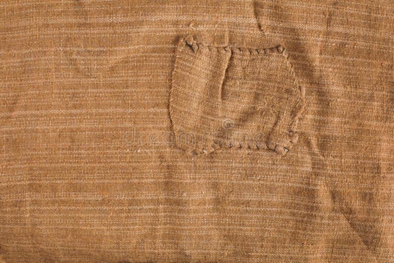 Текстура мешковины с темной виньеткой стоковые фото