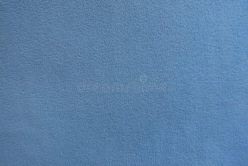 Текстура небесно-голубой ткани ватки стоковая фотография