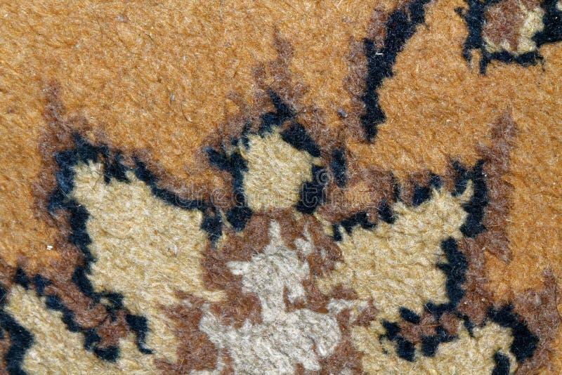 Текстура персидского ковра, абстрактного орнамента макроса Ближневосточная традиционная предпосылка ткани ковра стоковое изображение rf