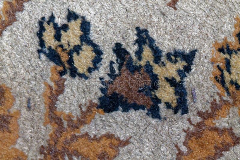Текстура персидского ковра, абстрактный орнамент цветка макроса Ближневосточная традиционная предпосылка ткани ковра стоковая фотография rf
