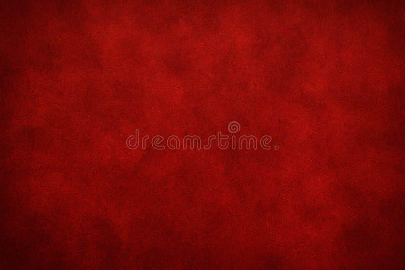 Текстура покрашенной бумаги красного цвета рождества или предпосылка года сбора винограда стоковые изображения