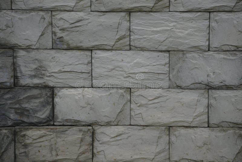 Текстура, предпосылка декоративный кирпич, строя украшение малый прямоугольный блок типично сделанный из увольнянной или солнц-вы стоковые изображения rf