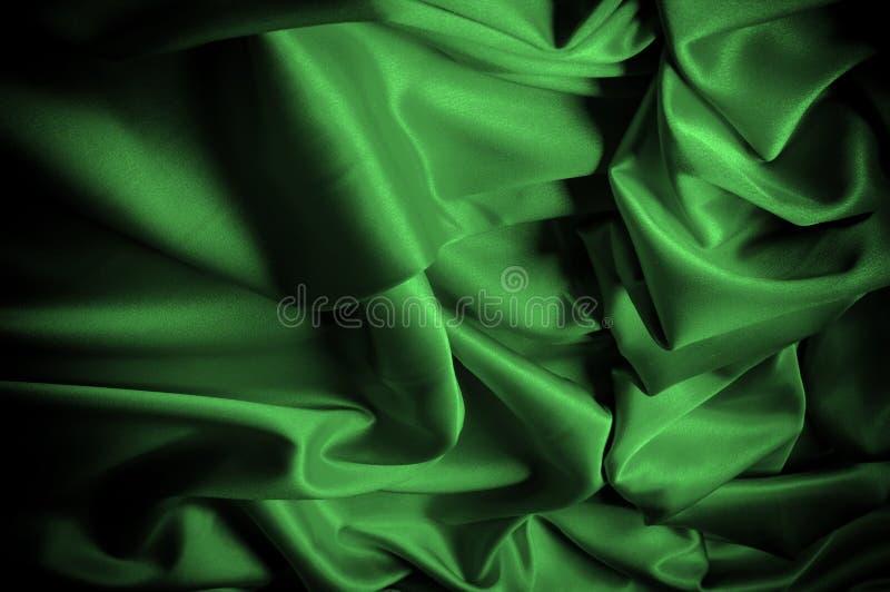 Текстура, предпосылка, картина Шелк ткани темные ые-зелен выразьте стоковые фото