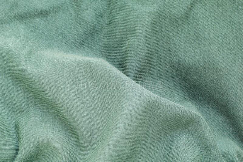 Текстура предпосылки зеленая мягкая волнистая ткань, взгляд сверху, конец-вверх стоковые изображения rf