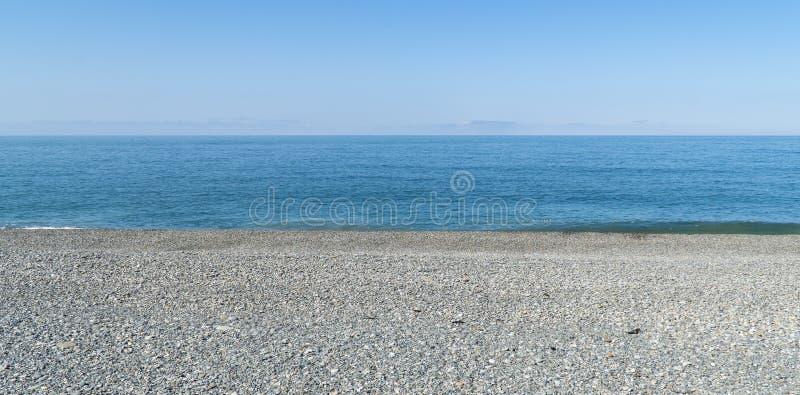 Текстура предпосылки камешков моря неба стоковое фото rf