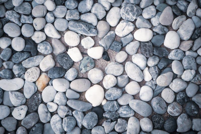 Текстура предпосылки от предпосылки природы пляжа моря камешков камней цвета небольшой стоковая фотография