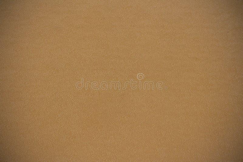 Текстура предпосылки сделана из виньетки обложки книги бежевой стоковые изображения