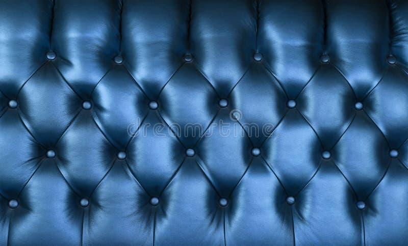 Текстура предпосылки capitone сини индиго кожаная стоковая фотография