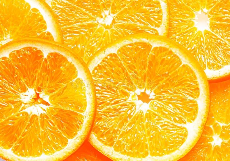 Текстура предпосылки свежих оранжевых кусков стоковое фото rf