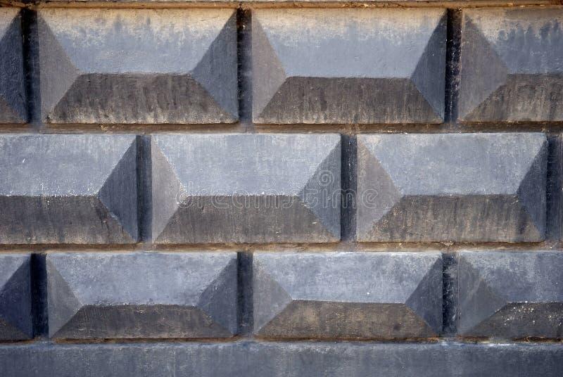 Текстура предпосылки старой серой конкретной загородки с картиной кирпича стоковое изображение rf