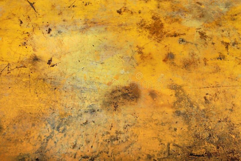 Текстура предпосылки стены желтая стоковые изображения rf
