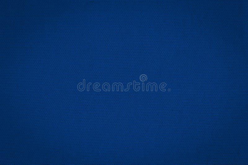 Текстура реальное темно-синего вяжет Предпосылка ткани стоковая фотография rf