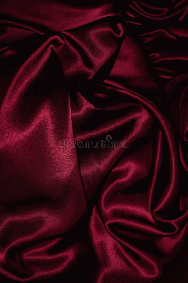 текстура сатинировки burgundy близкая вверх стоковые изображения