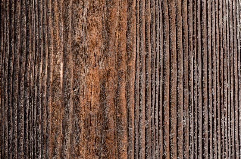текстура старая коричневая деревянная доска с черными сторонами стоковое изображение