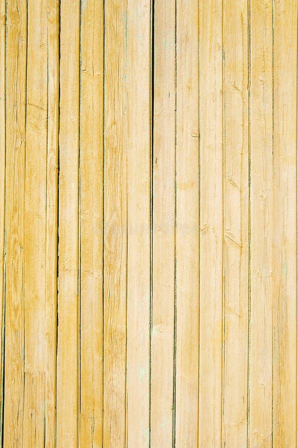 Текстура старой желтой краски на деревянных досках стоковые изображения