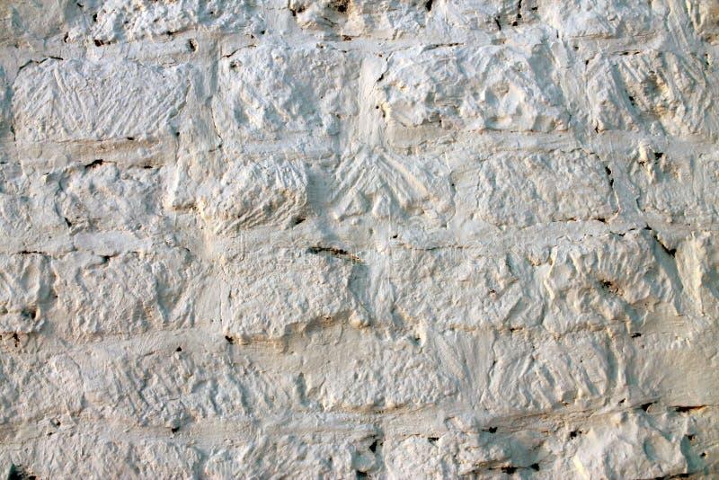 текстура старой кирпичной стены покрытой с белым минометом для предпосылки стоковые фотографии rf