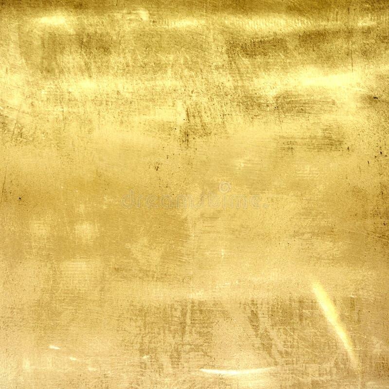 Текстура стены grunge металла золота стоковая фотография