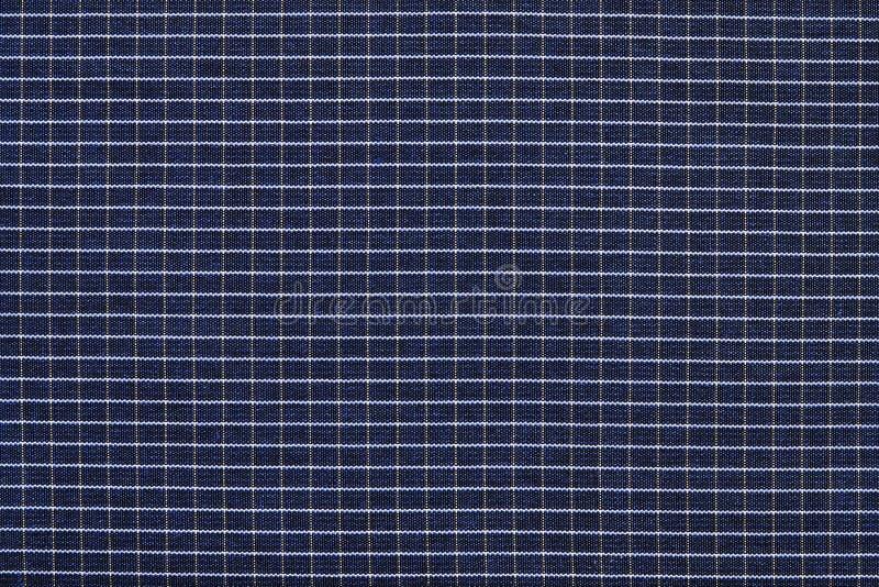 Текстура ткани в клетке стоковое фото