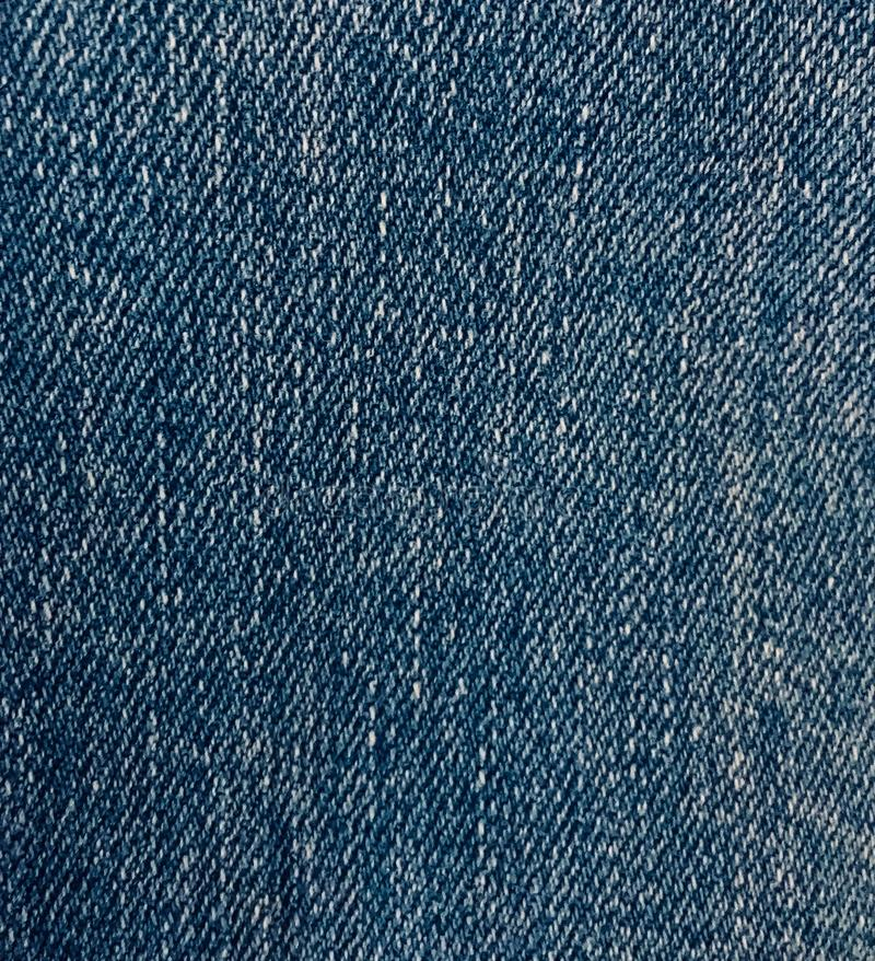 Текстура ткани голубых джинсов стоковое фото