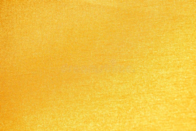 Текстура ткани золота с отражением для предпосылки стоковая фотография rf