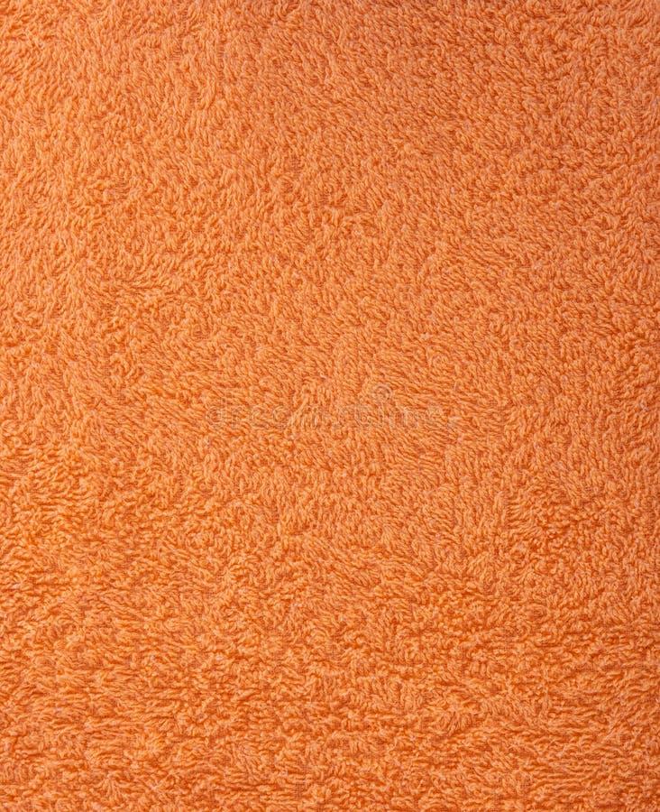 Текстура ткани оранжевое полотенце Terry Ткань Терри как предпосылка стоковые изображения