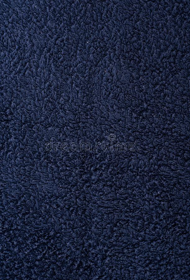 Текстура ткани темно-синее полотенце Terry Ткань Терри как предпосылка стоковые изображения rf