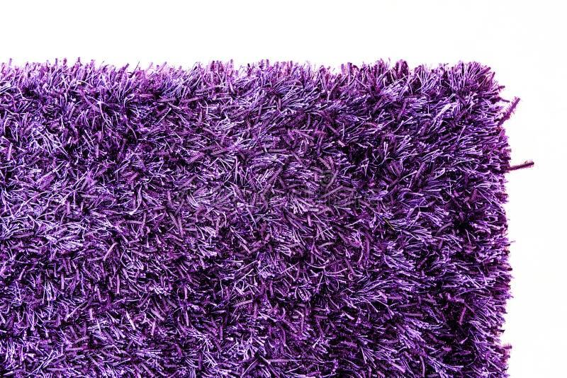 Текстура фиолетового угла ковра стоковое изображение rf