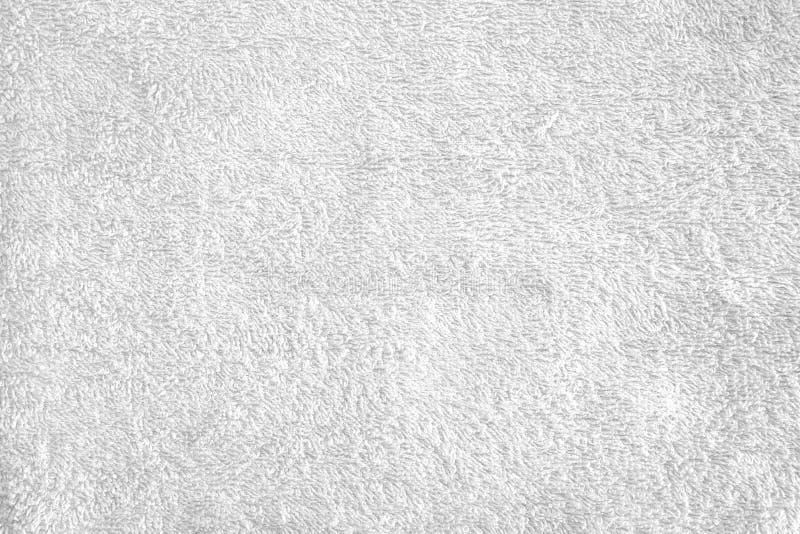 Текстура яркого белого полотенца ванны стоковое фото