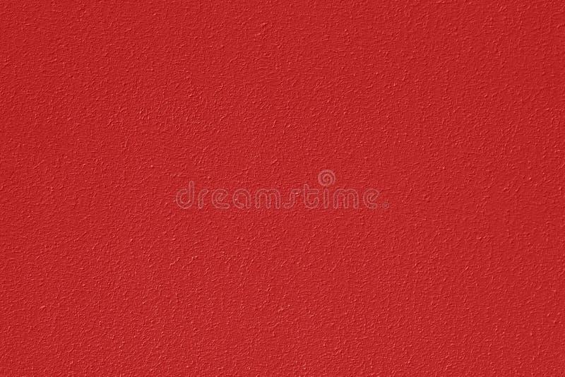 Текстурированная поверхность стены, покрашенная в терракотовом цвете Заштукатуренная предпосылка бетонной стены в высоком разреше стоковое изображение