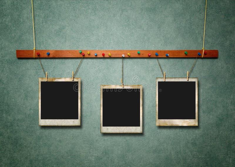 Текстурированные рамки фото на зеленом цвете стоковые изображения rf