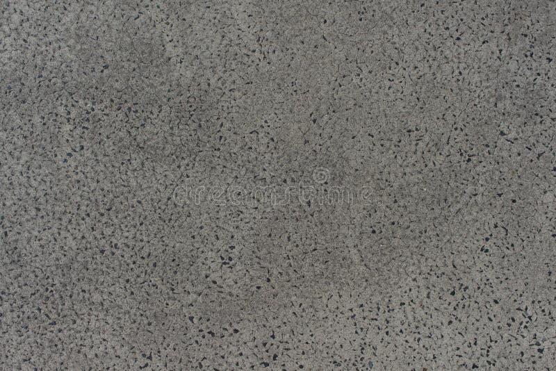 Текстурируйте земную предпосылку серого цвета вымощая камней на открытом воздухе стоковое фото
