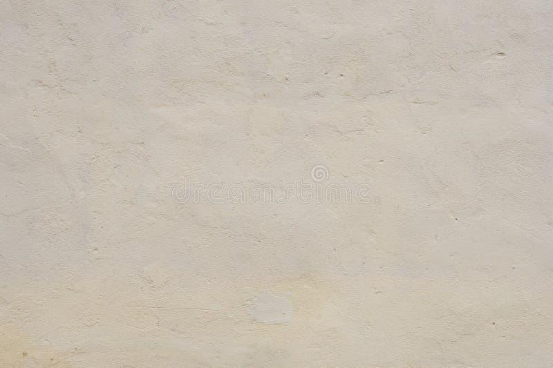 Текстурируйте мягко выровнянную стену покрашенную бежом цементированную, Стена внешней текстуры внешняя внешних стен стоковая фотография rf