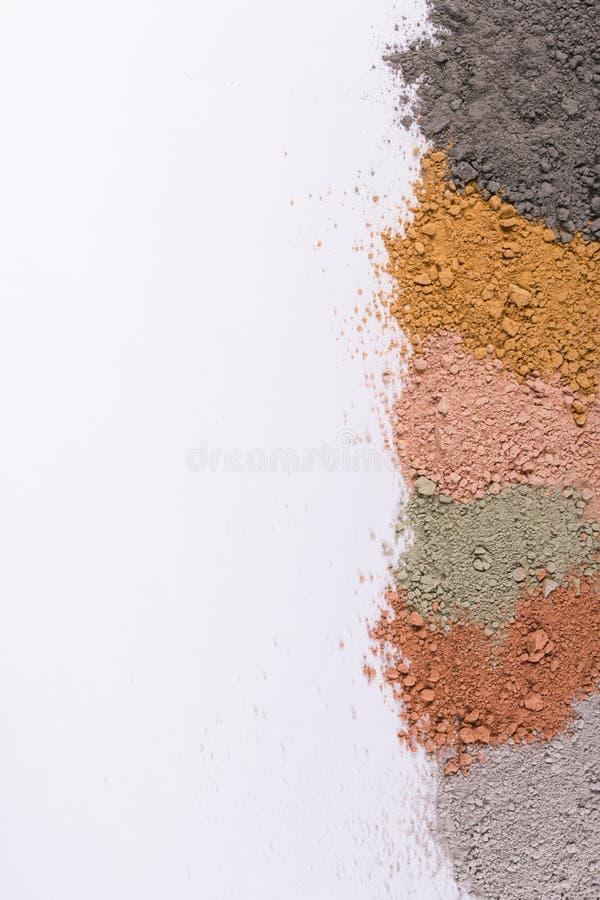 Текстурный градиент от различных косметических порошков глины стоковая фотография
