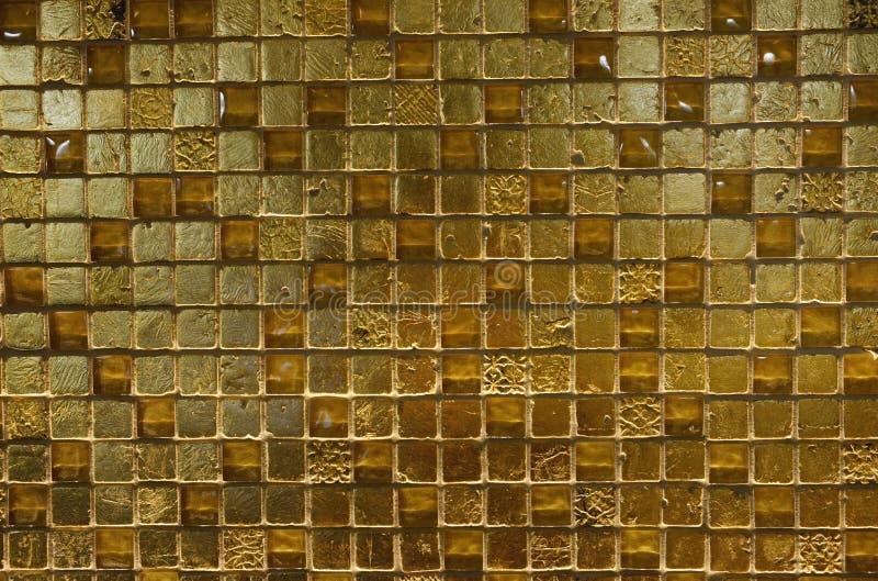 Текстуры - сияющие золотые плитки стоковые фото