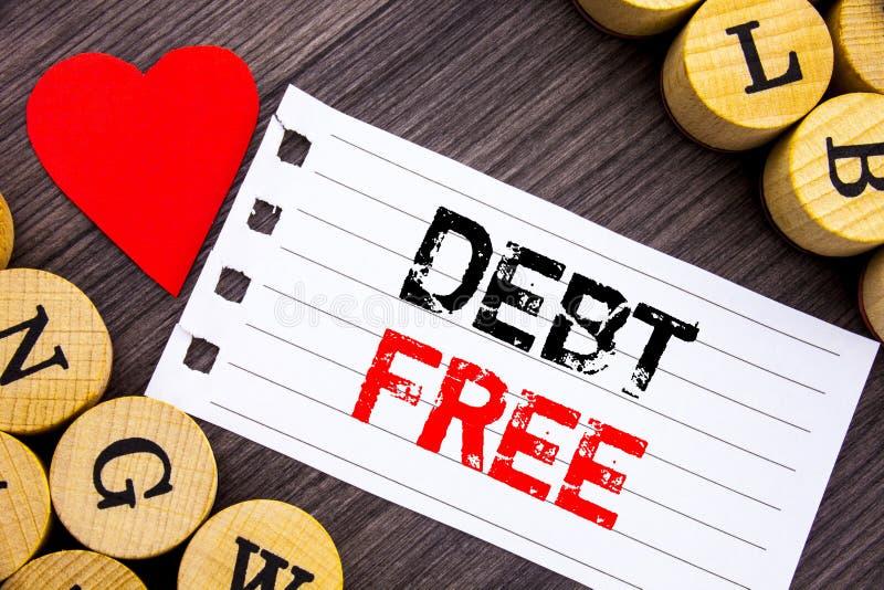 Текст почерка показывая задолженность свободно Свобода знака схематических денег кредита фото финансовая от ипотеки займа написан стоковые изображения rf