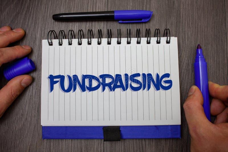 Текст сочинительства слова Fundraising Концепция дела для искать финансовой поддержки для причины призрения или удерживания владе стоковое изображение rf
