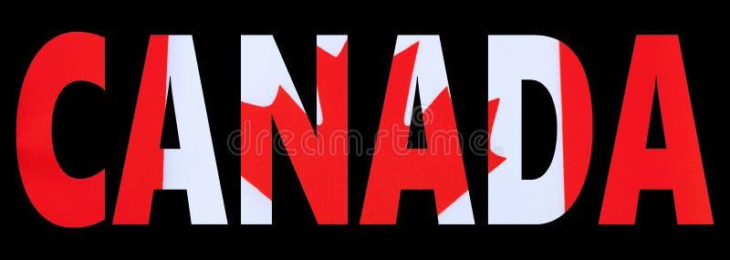 Текст флага Канады на черной предпосылке стоковое фото