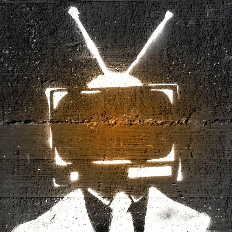 Телевидение на голове ` s персоны стоковое фото