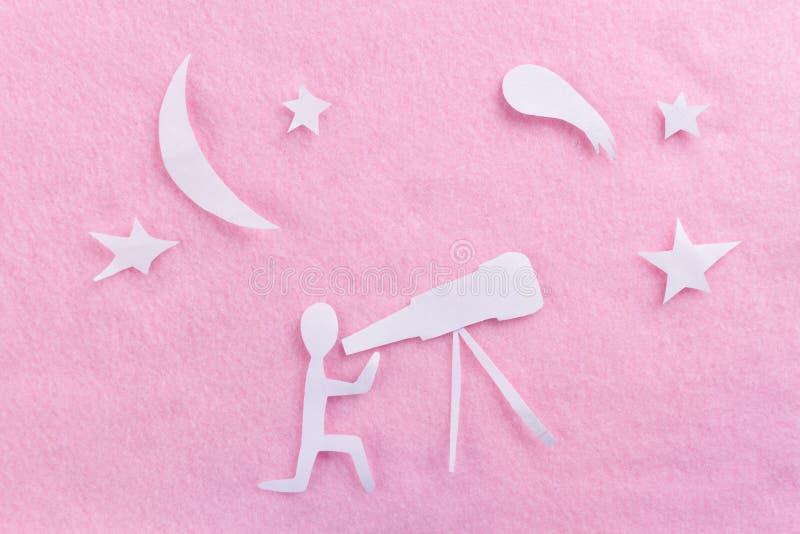 телескоп на розовой предпосылке стоковая фотография