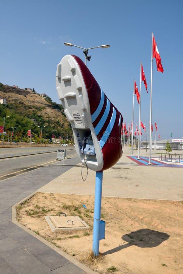 Телефонная будка в форме ботинка футбола на стадионе Senol Gunes стоковая фотография rf