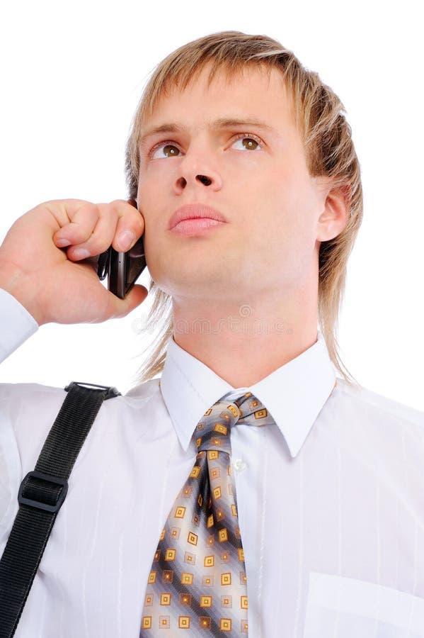телефон бесед бизнесмена клетчатый унылый стоковая фотография