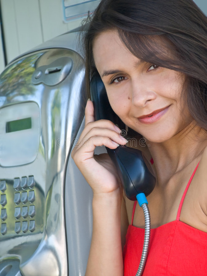 телефон девушки будочки стоковая фотография rf