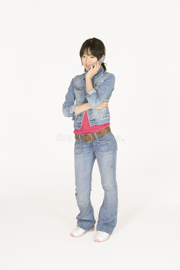 телефон девушки клетки подростковый стоковые фотографии rf